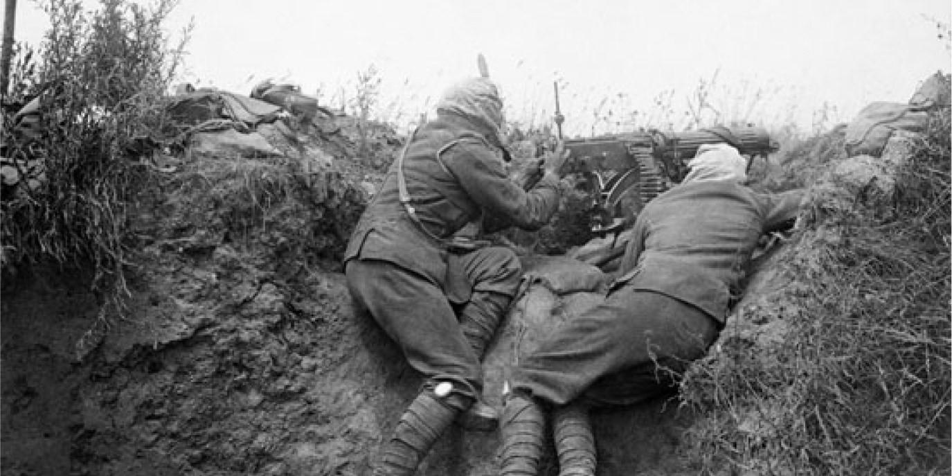Two allied soldiers defending in a trench during the First World War