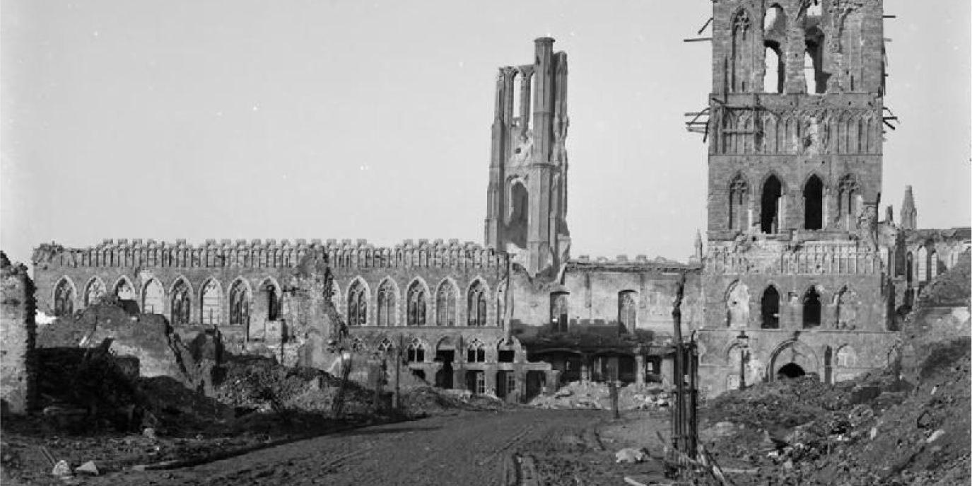 Black and white image of the ruins of Ypres with the cathedral in the foreground, from World War 1