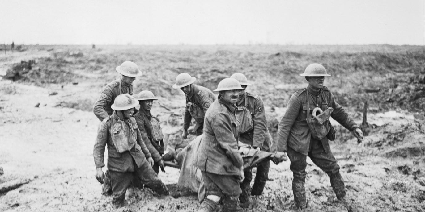 Allied soldiers carrying an injured soldier from No Man's Land