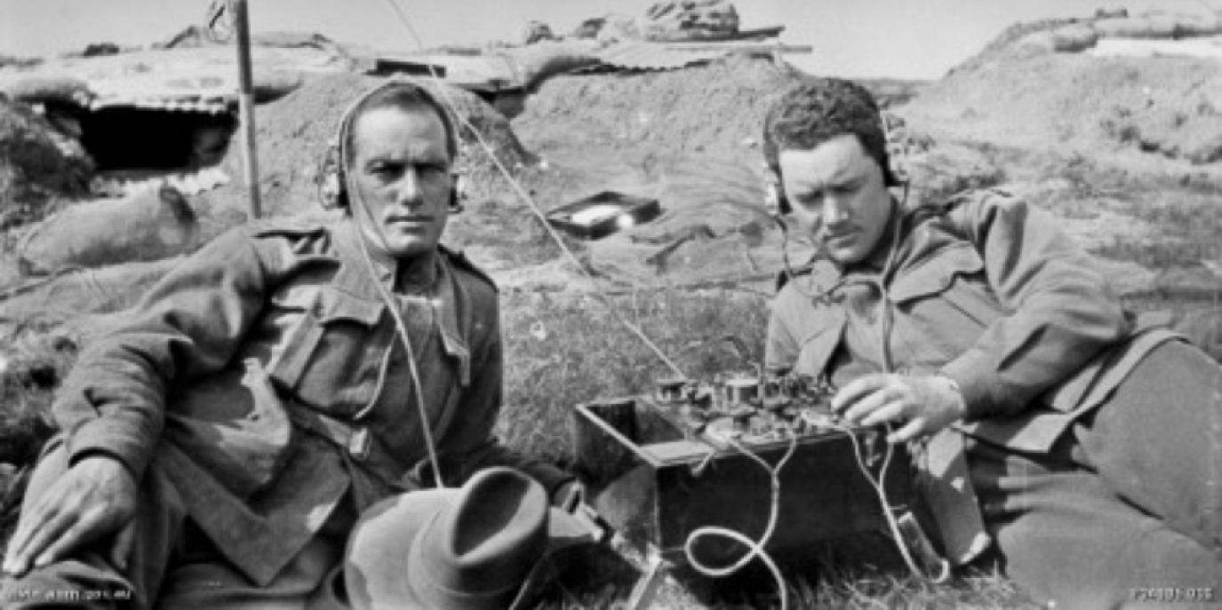 Two australian signallers in a trench with headphones on, 1916